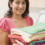 Woman Holding Fresh Laundry
